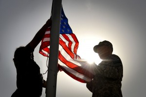 1280px-US_Navy_100911-F-3682S-033_Fire_Controlman_1st_Class_Andrew_Eden,_right,_and_French_Army_Sgt._Lydia_Briand_prepare_to_raise_the_American_Flag_at_Ka