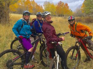 Cross Country Biking Group Photo of Tara Chisum Owner and Real Estate Listing Specialist
