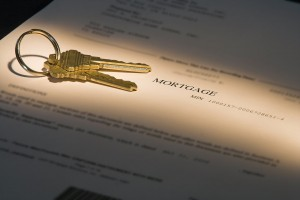 highlighted mortgage document and house keys