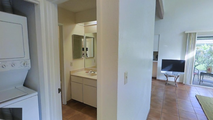 Laundry in the hallway centrally located in the condo