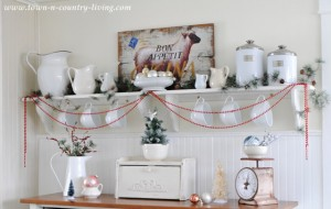 Vintage Vignettes! Have a handful of mismatched holiday heirlooms?  Create a charming holiday display for an interesting touch to any Christmas decor style.  Group old serving dishes, vases, or candle sticks together for an nostalgic holiday look.