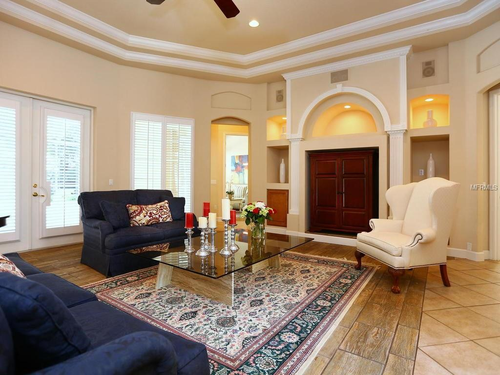 Luxurious architectural accoutrements including 23-foot ceilings, extensive wood crown moldings, 18-inch ceramic tiles and vaulted ceilings. Click here to view listing: 2131 McClellan Parkway, Sarasota