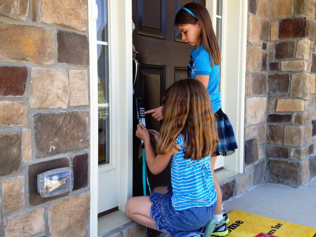 Girls opening Door