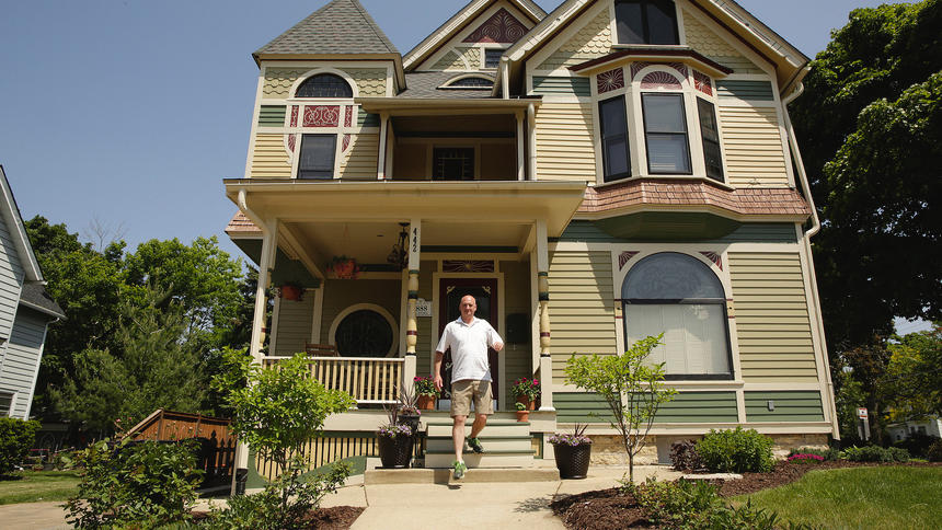 Chris Berry poses for a portrait in front of his 6-color 1881 home on DuPage Street on May 23, 2016 in Elgin, Ill. Berry and his wife have been restoring the home since they bought it in 2012.  (Stacey Wescott/Chicago Tribune/TNS)