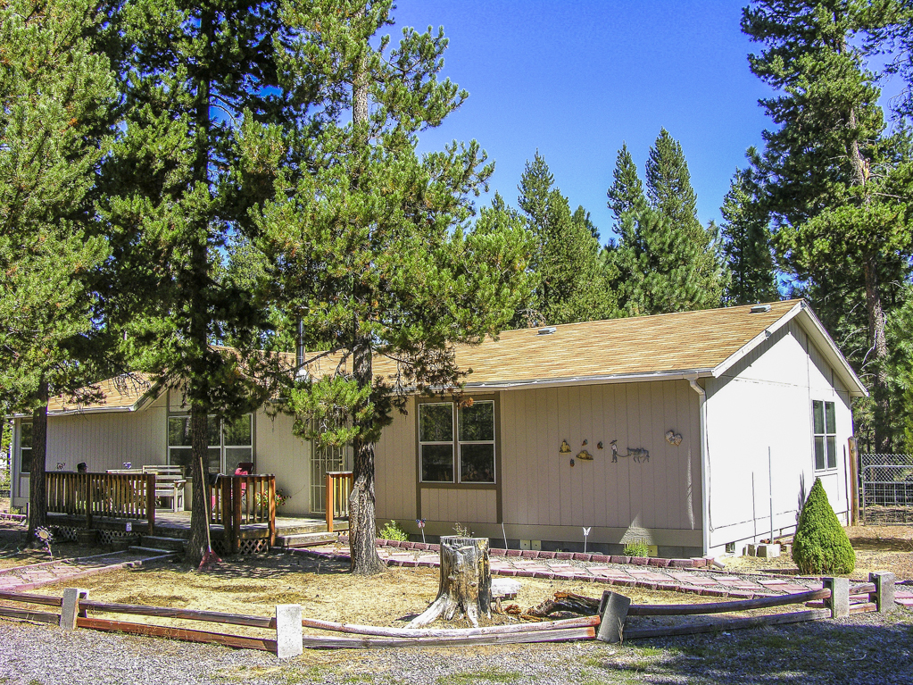 Well maintained home and shop on 1+ acres