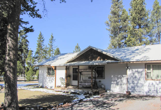 Single level living on nearly an acre with a great shop!