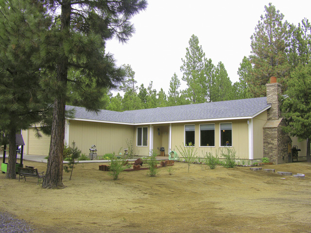 Very custom 4 bedroom home on 1+ acre with shop and trout pond!
