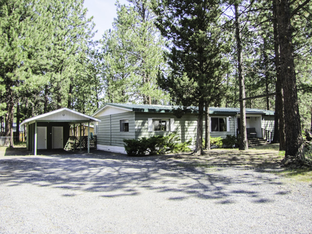 Simple and Clean 3 Bedroom/2 Bath home with large lot and great back deck, in Romaine Village.