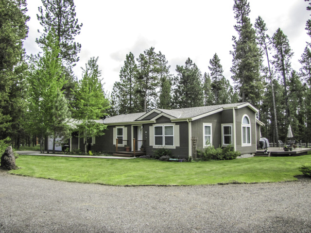 Impressive turn-key 3br/2ba home on nearly 2.5 acre set up for horses.