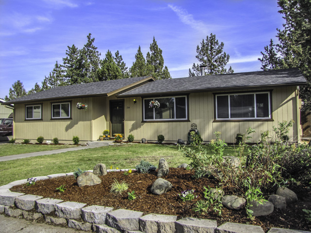 Freshly remodeled single level 3 bedroom home with large lot and a detached garage/shop.