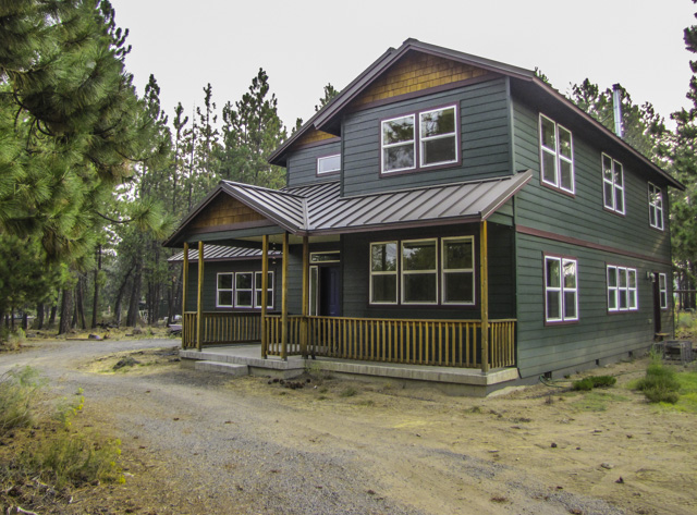 Impressive craftsman on over 4 acres with shop and separate living space!