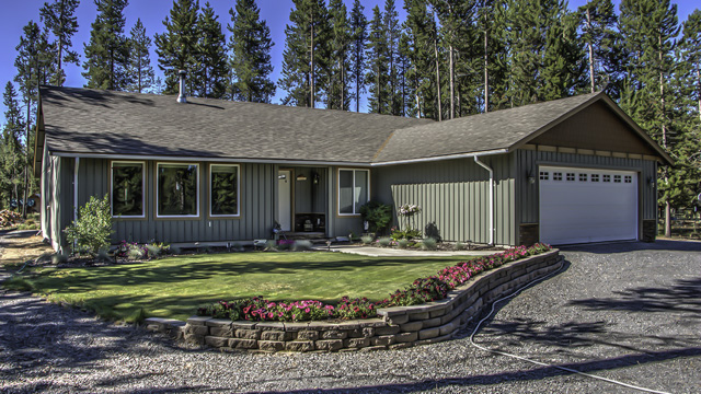 Well-kept single level 4 bedroom/2 bathroom home sits elevated on over an acre lot.