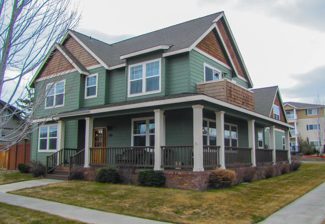 Classic Bend 2-story home with wrap-around porch, great character, and prime location.