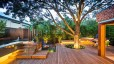 Impressive-Wooden-Deck-Created-using-Prestigious-Rustic-Summer-Backyard-Ideas-Completed-with-Fascinating-Colorful-Outdoor-Sitting-Space-and-Outdoor-Lights-909x607