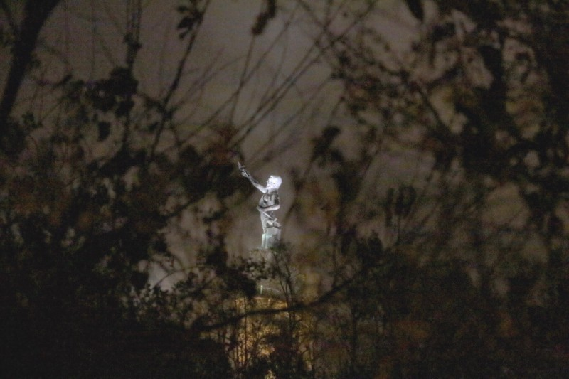 A view of Vulcan through the trees from a nearby home in Birmingham's Southside community.