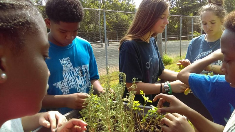 Kids working on a gardening project in the Ensley community.