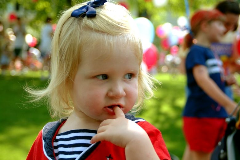 Little girl dressed in red, white and blue.