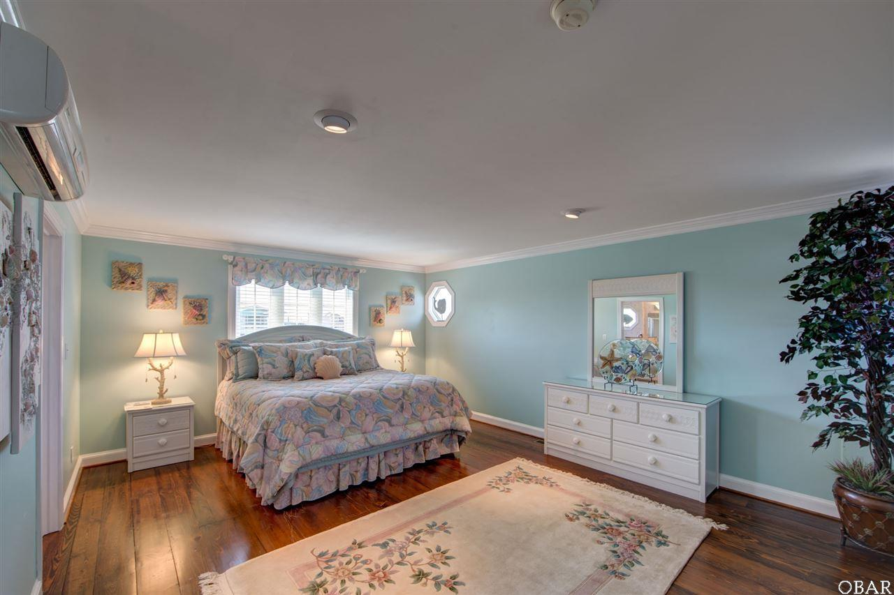 Photo of the master bedroom of 57195 M. V. Australia Lane in Hatteras, NC. This listing is for sale by Trisha Midgett.