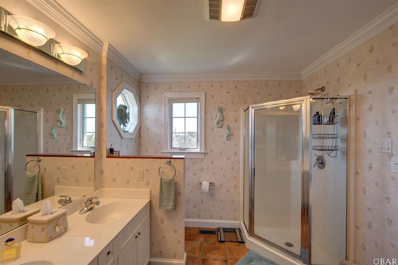 Photo of the Master Bathroom of 57195 M. V. Australia Lane in Hatteras, NC. This listing is for sale by Trisha Midgett.