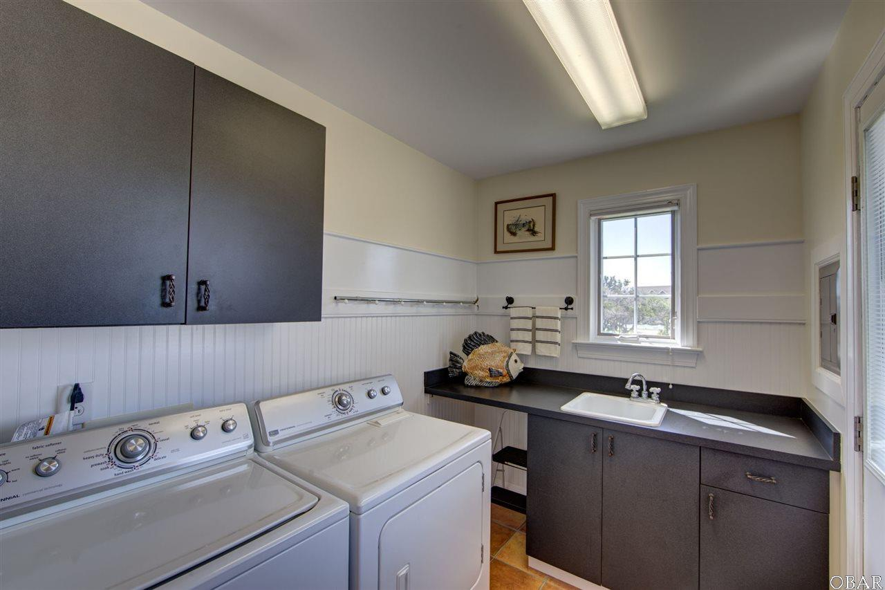 Photo of the laundry room of 57195 M. V. Australia Lane in Hatteras, NC. This listing is for sale by Trisha Midgett.