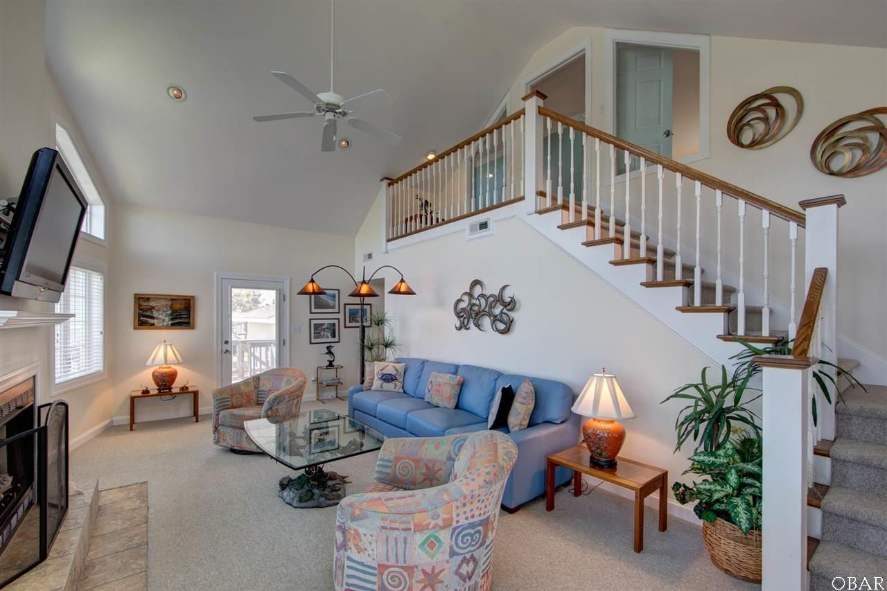 Photo of the living room of 57195 M. V. Australia Lane in Hatteras, NC. This listing is for sale by Trisha Midgett.