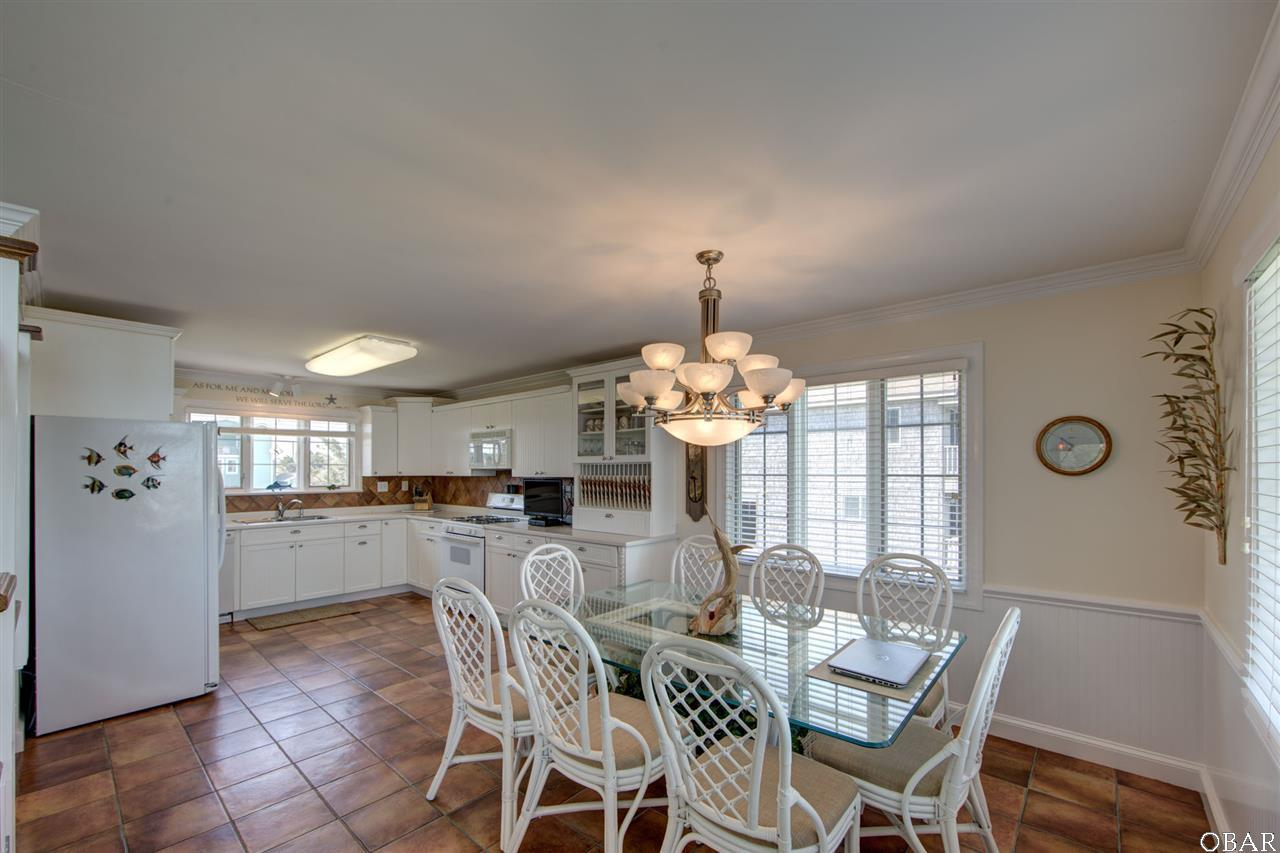 Photo of the kitchen and dining room of 57195 M. V. Australia Lane in Hatteras, NC. This listing is for sale by Trisha Midgett.