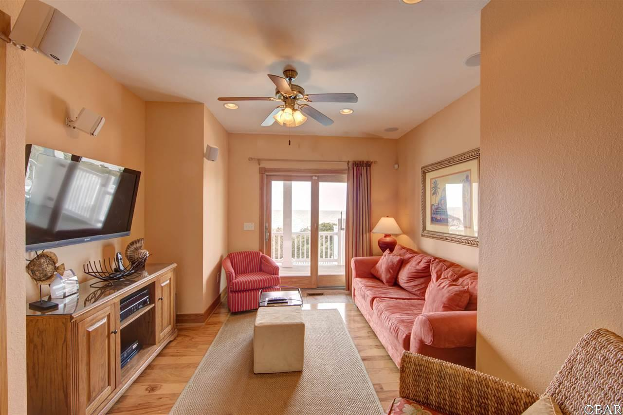 """The media room of """"3 Martinis"""" a rental property for sale in Avon, NC. This listing is for sale by Trisha Midgett"""