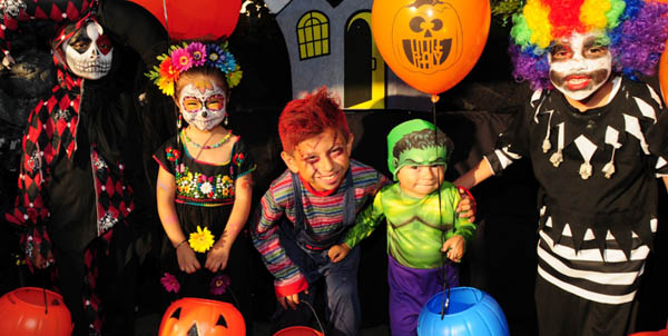 Children in costume trick-or-treating on India Street. October events in San Diego