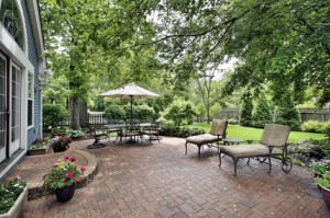 Brick patio with table umbrella and chairs