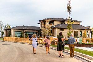 Visitors walking between homes at 2019 VIP night