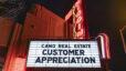 Kiggins Theatre marquee at night, Cano Real Estate Customer Appreciation