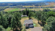 Aerial view of 35901 NW 41st Ct, Woodland, WA 98674. 5.41 acre property with surrounding trees