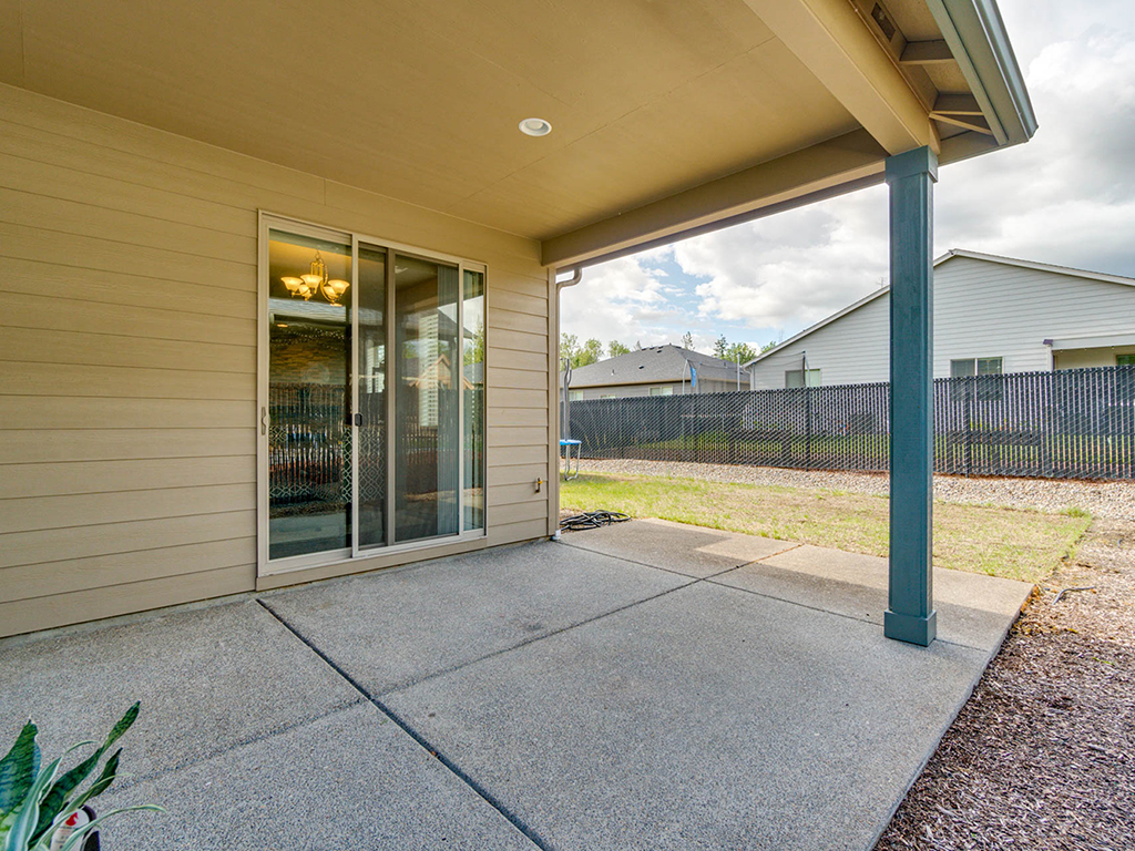 Covered patio in fenced backyard - 153 Zephyr Dr, Silver Lake, WA 98645