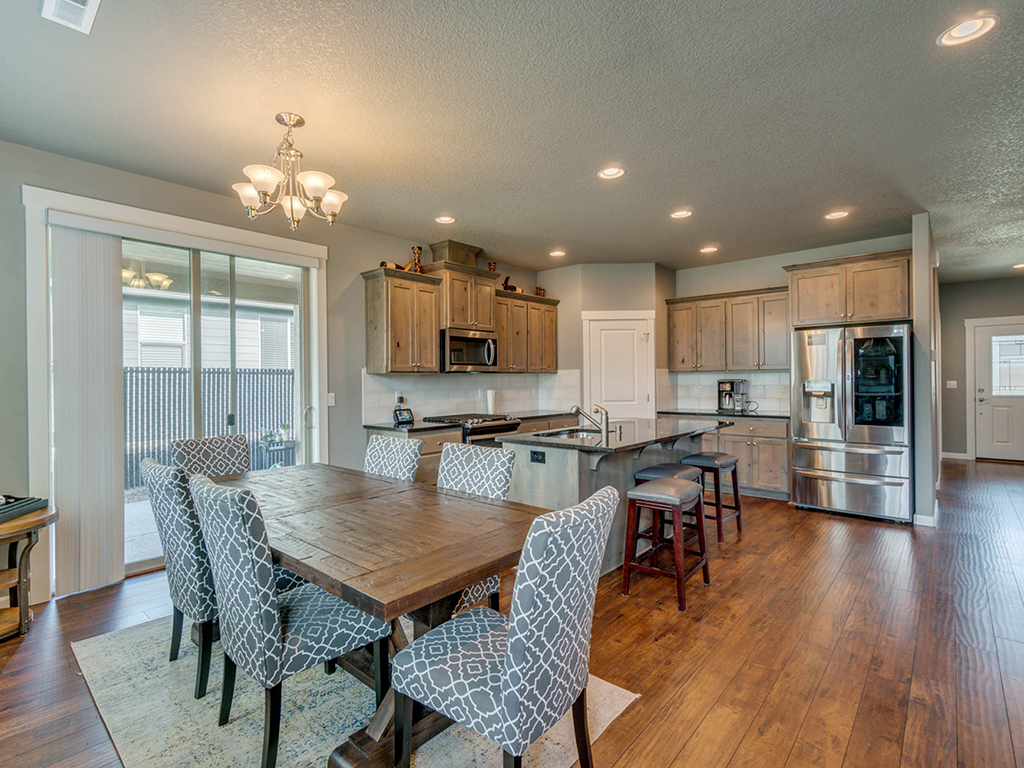 Dining area open to kitchen - 153 Zephyr Dr, Silver Lake, WA 98645