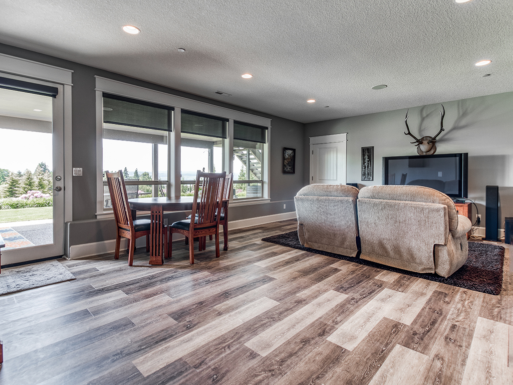 Lower level family room with patio access - 307 Milky Way Dr, Woodland, WA 98674