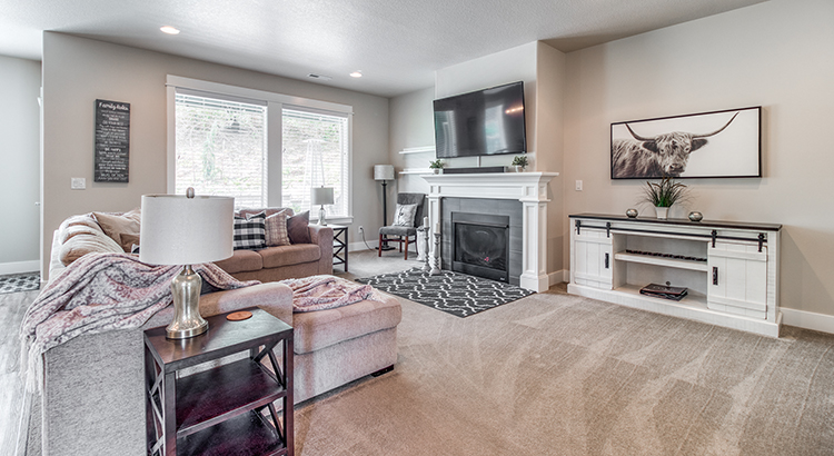 Living room with fireplace, wall to wall carpet