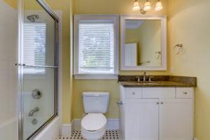 Tile flooring and updated vanities in bathrooms