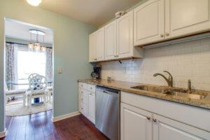 Galley kitchen with subway tile backsplash