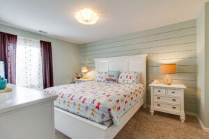 Spacious master bedroom with Shiplap detailing