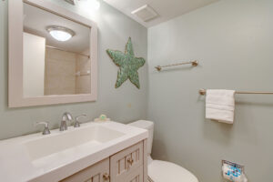Update master bathroom with new vanity and tile shower