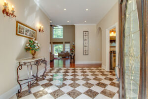 welcoming foyer with checkered tile details