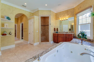 Large master bathrooms with double vanities, jetted tub, and walk in shower