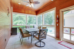 screened in porch with tile flooring
