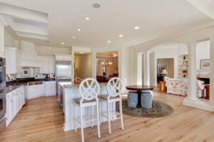 The great room flows in the kitchen and family room