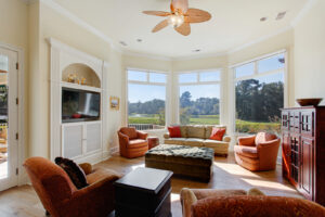 Family room looks over the golf course and lagoon views