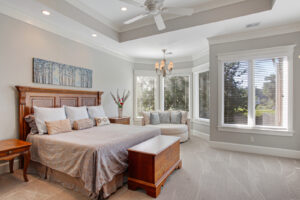 Spacious master bedroom with tray ceilings