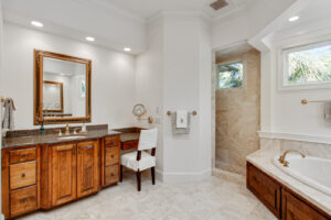 Large master bathroom with dual vanities, jetted tub, and tiled walk-in shower