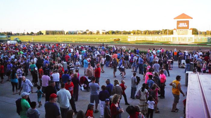 crowd of people waiting for fireworks at Prairie Meadows Racetrack