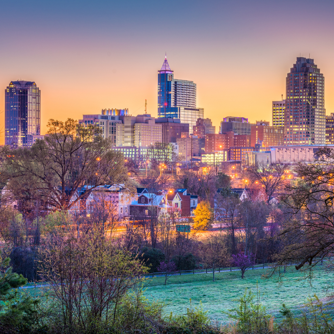 City skyline of Raleigh, NC at sunset.