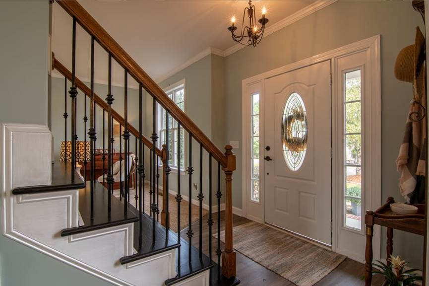 A home's entrance with different fixtures and finishings pre-installed.